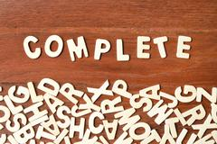 Word complete made with block wooden letters - stock photo