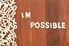 Word impossible made with block wooden letters - stock photo