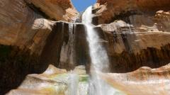 Beautiful shot of lower calf creek falls in the desert of Southern Utah Stock Footage