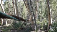 Gimbal shot of a rope monkey bridge at a scout camp Stock Footage