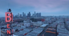 Aerial view of historic Bendix tower and downtown Los Angeles skyline at dusk Stock Footage