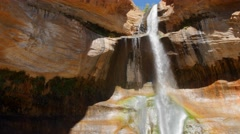 The lower calf creek falls at the desert of Southern Utah Stock Footage