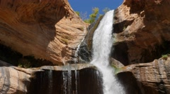 The lower calf creek falls in the desert of Southern Utah Stock Footage