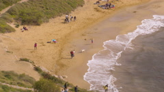 Tourists on the beach in Malta Stock Footage