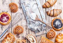 Delicious holiday baking background with ingredients and utensils Stock Photos