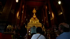 Bangkok, Thailand. Circa. Tourists visit the Phra Buddha Theva Stock Footage