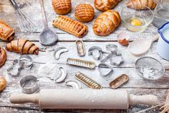 Delicious holiday baking background with ingredients and utensils - stock photo
