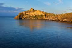 Beautiful Cape Kapchik in the Black Sea illuminated rising sun. Crimea Stock Photos