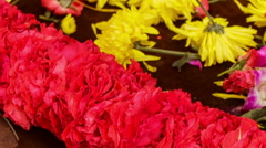Woman Hands Compose Yellow Red Flower Garland Stock Footage