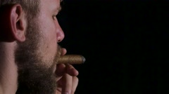 Detail of a person smoking cigar. Black. Close up Stock Footage