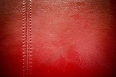 Sewing red leather texture background Kuvituskuvat