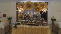 sweet buffet birthday party. gold sweet buffet with light star - stock footage