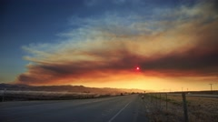 Smoke cloud Coleman Fire wildfire over Freeway 101 California sunset. Timelapse Stock Footage