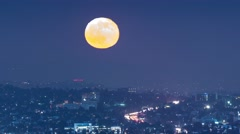 Full moon rising above city of Los Angeles cityscape skyline. 4K UHD timelapse. Stock Footage