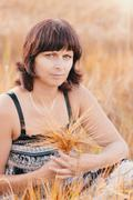 Middle aged beauty woman in barley field Stock Photos