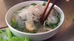 Vietnamese cheap vegetarian rice noodle soup - hu tieu chay Stock Footage