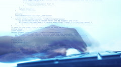 Programming code running with man typing on keyboard , Concept Stock Footage
