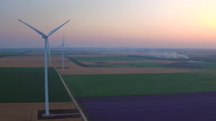 Aerial view of a landscape with lavender field and wind turbine at sunset Stock Footage