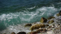 Sea wave smashes in the stony shore Stock Footage