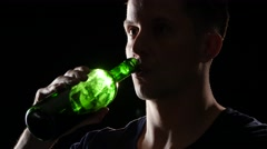 Drinking wine from the bottle. Back light. Close up - stock footage