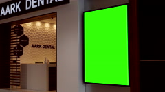 Green billboard for your ad beside Aark dental in Coquitlam shopping mall Stock Footage