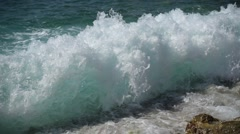 Incoming wave strucks the shore Stock Footage