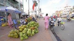 Coconut seller working at stree Stock Footage