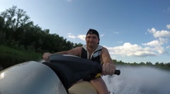 Guy ride on Jet Ski Stock Footage