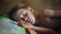 Little boy sleeping, he wakes up and stretches Stock Footage