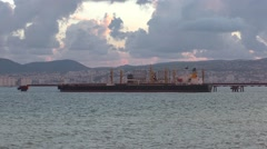 Barge Floating in Open Sea, Not Far From Coast With Small City Stock Footage