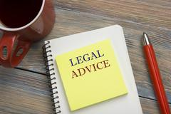 Legal Advice. Notepad with message, coffee cup and red pencil. Office supplies Stock Photos