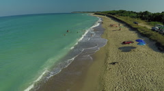Aerial view of coastline and wild beach. Flight above sea and waves Stock Footage