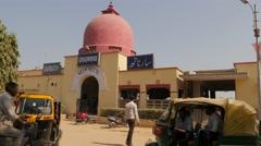Railway station with auto rickshaws waiting,Sarnath,India Stock Footage