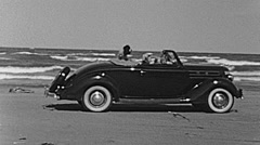 USA 1945: family sitting in the car in front of the ocean - stock footage