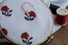 Hand embroidery cross-stitch flower ornament Stock Photos