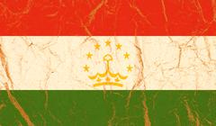 Tajikistan flag painted on crumpled paper background Stock Photos