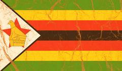 Zimbabwe flag painted on crumpled paper background - stock photo