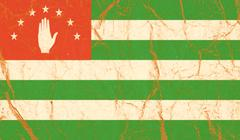 Flag of Abkhazia painted on paper texture - stock photo