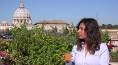 Business woman drinking glass of orange juice Rome Vatican relaxing after work Stock Footage