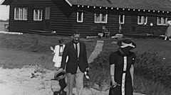 USA 1945: family walking in front of an house in the coutryside Stock Footage