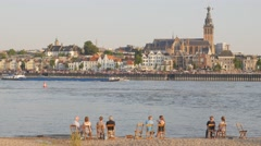 People watch view on Waal and city,Nijmegen,Netherlands Stock Footage
