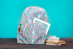 Back to School concept. Books, colored pencils and backpack Stock Photos