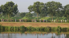 Vierdaagse walkers march along canal,Middelaar,Netherlands Stock Footage
