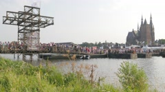 Pontoon bridge over maas and Martinus church,Cuijk,Netherlands Stock Footage