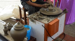 Professional thai old man using mechanic pottery made earthenware - stock footage