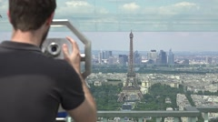 Male Tourist Watches Eiffel Tower Through Telescope, Paris Stock Footage
