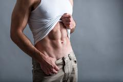Abs of athletic man Stock Photos