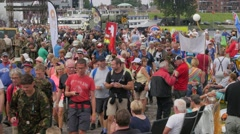 Crowded street and bridge with vierdaagse walkers,Cuijk,Netherlands Stock Footage
