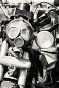 Detail of veteran motorbike with symbolic gas mask, black and white Stock Photos