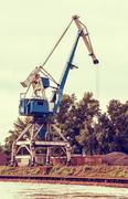 Blue crane in cargo port, retro photo filter Stock Photos